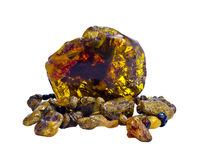 Nugget and old beads of Baltic amber Royalty Free Stock Photos