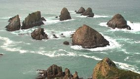 Nugget point at the Catlins in New Zealand stock footage