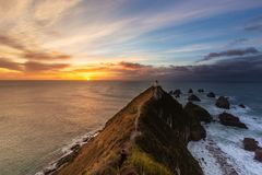 Free Nugget Point Lighthouse Is Famous Landmark In South Island, New Royalty Free Stock Photos - 116187498