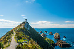 Nugget Point. Lighthouse on Nugget Point. It is located in the Catlins area on the Southern Coast of New Zealand, Otago region. The Lighthouse is surrounded by royalty free stock photo