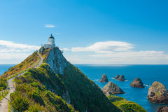 Nugget Point. Lighthouse on Nugget Point. It is located in the Catlins area on the Southern Coast of New Zealand, Otago region. The Lighthouse is surrounded by stock image