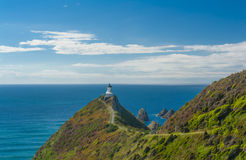 Nugget Point. Lighthouse on Nugget Point. It is located in the Catlins area on the Southern Coast of New Zealand, Otago region. The Lighthouse is surrounded by royalty free stock photos
