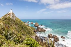 Nugget Point Lighthouse, is a popular tourist destination on New Zealand`s Catlins Coast. Nugget Point Lighthouse, a popular tourist destination on New Zealand`s Stock Photography