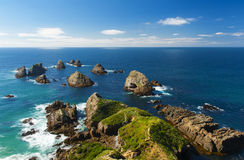 Nugget Point. Is located in the Catlins area on the Southern Coast of New Zealand, Otago region. The area is famous for many rock islands - nuggets - in the sea royalty free stock photo