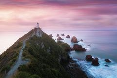 Nugget Point is one of the most distinctive landforms along the Otago coast of New Zealand. It`s a steep headland with lighthouse stock photos