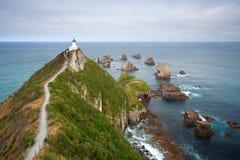 Nugget-Punkt, NZ Stockfoto