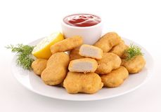 Nuggets. Isolated plate of nuggets with ketchup royalty free stock photos