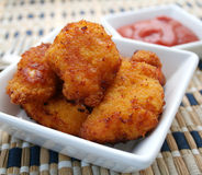 Nuggets. A bowl with fresh chicken nuggets and ketchup Royalty Free Stock Image