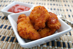Nuggets. A bowl with fresh chicken nuggets and ketchup Stock Images