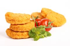 Nuggets. Tasty chicken nuggets with tomatoes stock images