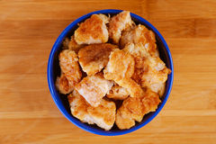 Nuggets in blue plate Royalty Free Stock Image