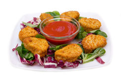 Nuggets chicken on salad Royalty Free Stock Photography