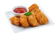 Nuggets des gebratenen Huhns getrennt auf weißem Hintergrund Lizenzfreie Stockfotografie