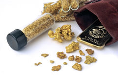 Nuggets and gold bullion Stock Photo