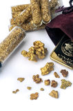 Nuggets and gold bullion Royalty Free Stock Images