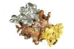 Nuggets. Gold, silver and copper nuggets isolated on white background royalty free stock image
