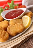 Nuggets and ketchup Stock Photography