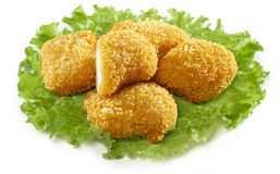 Nuggets on the lettuce. Some chicken nuaggets on the green lettuce Stock Photos