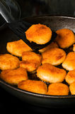 Nuggets with one nugget on spatula Stock Image