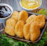 Nuggets in panirovke with sauce. On the table Stock Images