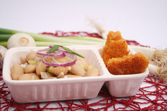 Nuggets and a salad of beans Royalty Free Stock Image