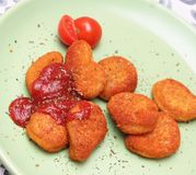 Nuggets. Some fresh chicken nuggets with ketchup Royalty Free Stock Photo
