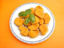 Nuggets. Some fresh nuggets of chicken meat Royalty Free Stock Image