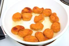 Nuggets. Some fresh nuggets of chicken meat in a pan Royalty Free Stock Photography