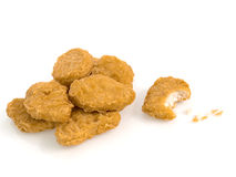 Nuggets whit a bite. On white background Stock Images