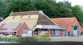 Renovation of a thatched roof. Nuis. May-11-2011. Renovation of a thatched roof in the village Nuis. The Netherlands royalty free stock photo