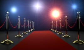 Nuit de charme - le tapis rouge et l'appareil-photo clignotent Photographie stock