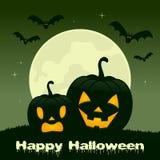 Nuit de Halloween - deux potirons et battes Photographie stock