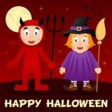 Nuit de Halloween - diable rouge et sorcière mignonne Photographie stock libre de droits