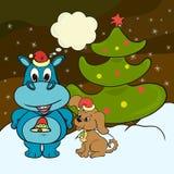 Nuit de Noël, un hippopotame et un chiot Photo stock