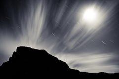 Nuit striée par nuage Photographie stock
