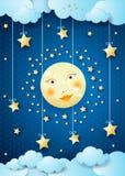 Nuit surréaliste avec la pleine lune et les étoiles accrochantes Photographie stock