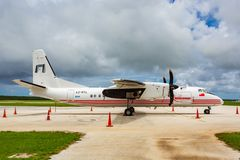 REALTonga Chinese built Xian MA60 turboprop airplane. Fua`amotu International Airport`s apron, Tonga Kingdom, Polynesia, Oceania. Nuku`alofa, Tonga - Jan 4 2014 stock photos