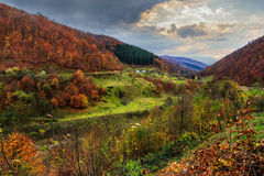 Nullah near village in autumn mountain landscape Stock Photo