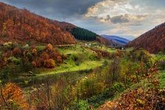 Nullah near village in autumn mountain landscape Stock Photo