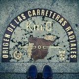 Nullpunkt des Kilometers in Puerta del Sol, Madrid, Spanien, mit einem Re Lizenzfreies Stockfoto