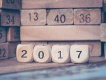 Numéro 2017 avec la nouvelle année sur des blocs de nombre de jouet Image stock