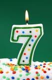 Numéro bougie de sept anniversaires Photos libres de droits