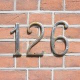 Numéro de maison 126 Photos libres de droits