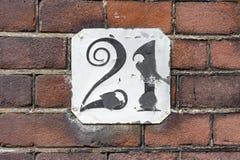 Numéro de maison vingt un 21 Photographie stock