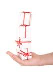 Numéro des cadeaux sur la paume Photographie stock libre de droits