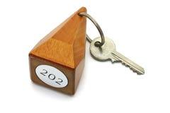 Numéro et clé de chambre d'hôtel Photos stock