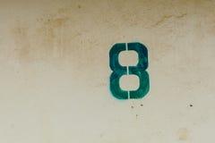 Numéro huit avec le mur grunge Photographie stock libre de droits