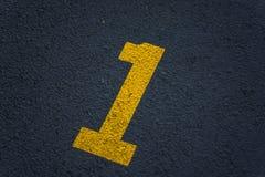 Numéro marqué au poncif un 1 sur le trottoir Images libres de droits