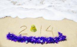 Numéro 2014 sur la plage sablonneuse - concept de vacances Photos libres de droits