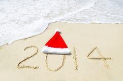 Numéro 2014 sur la plage sablonneuse - concept de vacances Image libre de droits